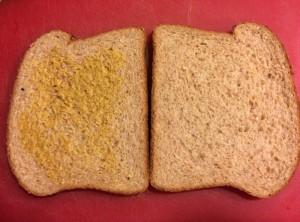 Two slices of multi-grain bread, mustard
