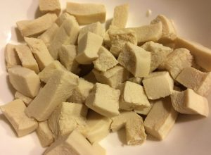 Tofu, cut up, boiled, drained, squeezed dry