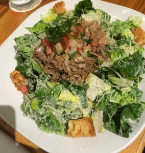 Pineapple Room Caesar Salad Kula Baby Romaine Lettuce, Lomi Tomatoes Choice of: Kalua Pig or Huli Spiced Grilled Chicken