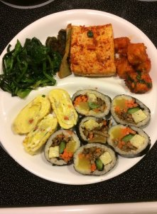 Kimbab, Rolled Egg Omelet, Prepared Choi Sum, Spicy Fried Tofu (two ways)